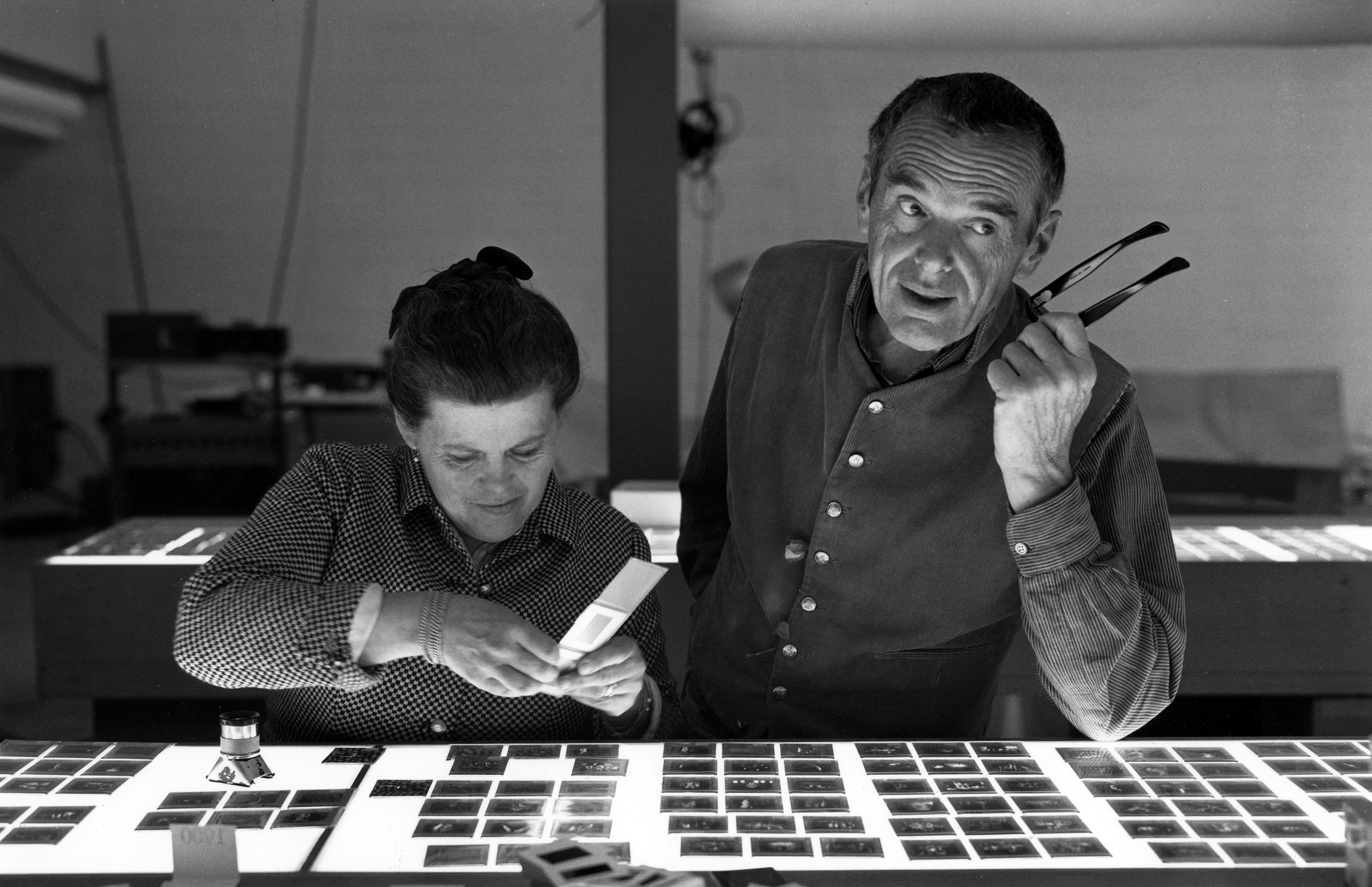 Charles and Ray Eames selecting slides ® Eames Office LLC
