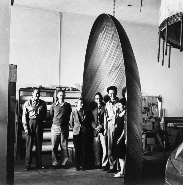 Staff of Evans Products Molded Plywood Division with plywood blister for glide ® Eames Office LLC