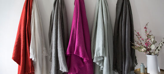 selection of throws displayed on wall
