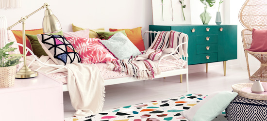 day bed surrounded by colourful decor