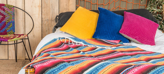 vibrant bed linen and brightly coloured cushions