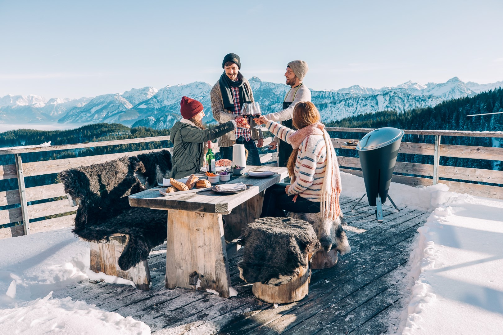 group of people drinking outside in snow