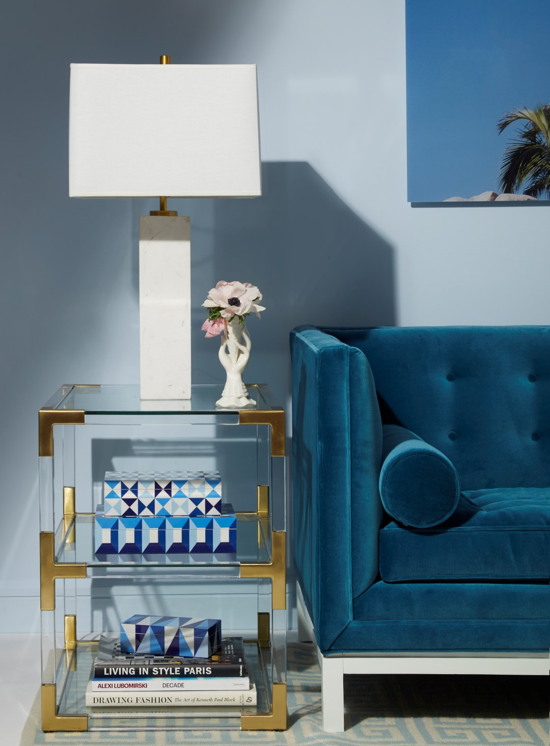 Blue sofa next to coffee table with blue walls