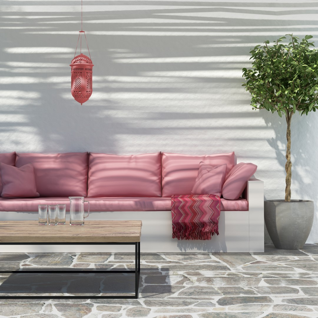 Pink sofa and cushions outside