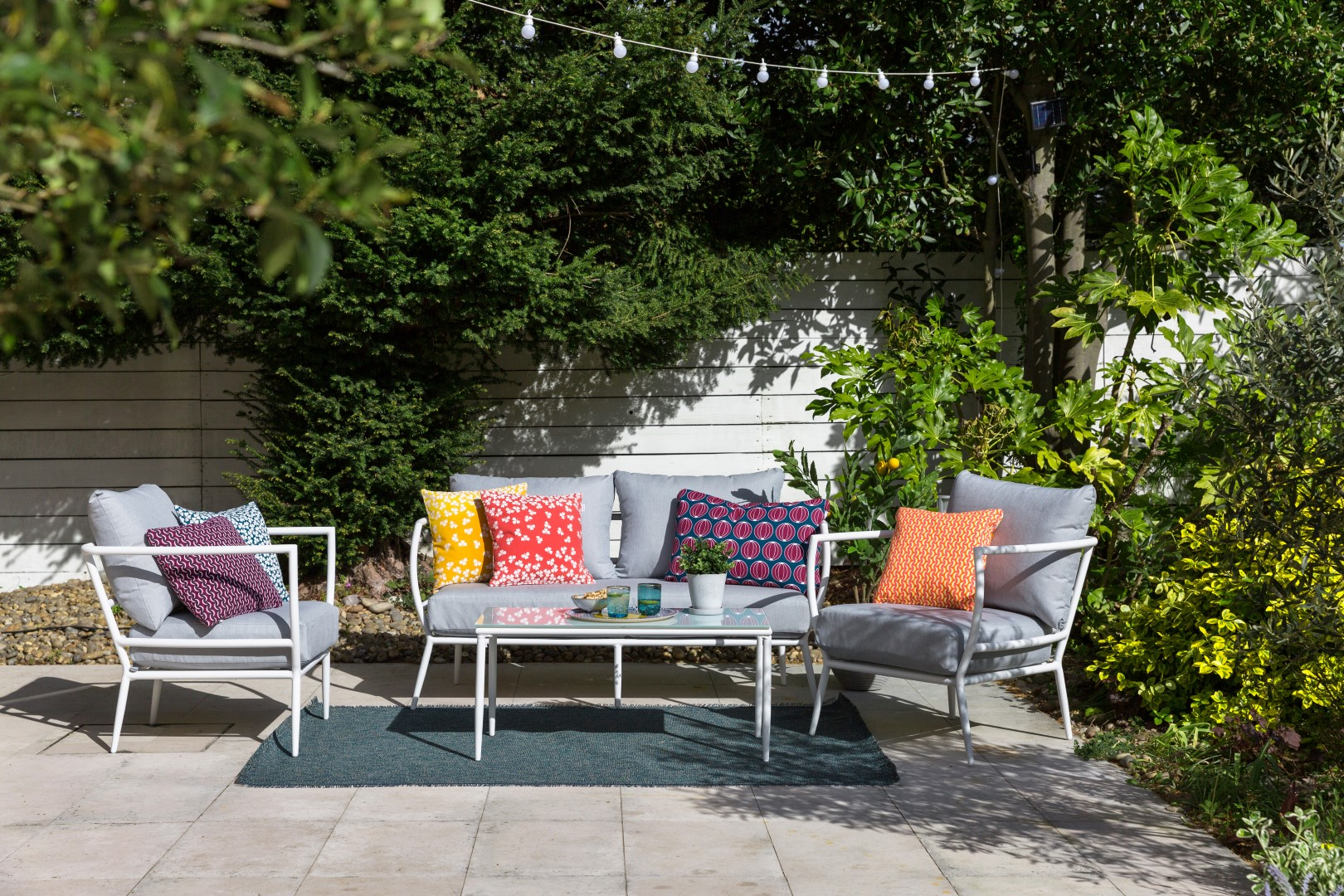 Outdoor Table And Chairs In Garden With Cushions